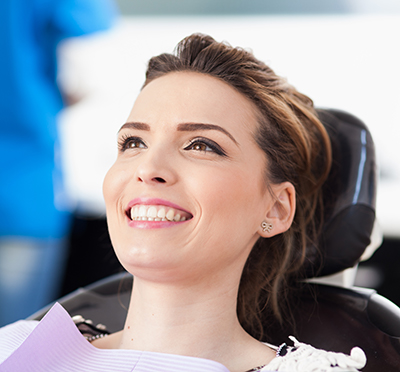 woman smiling after dental crowns procedure