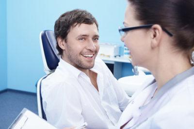 man talking to dentist about dental veneers