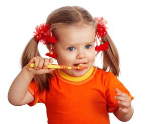 young girl brushing her teeth