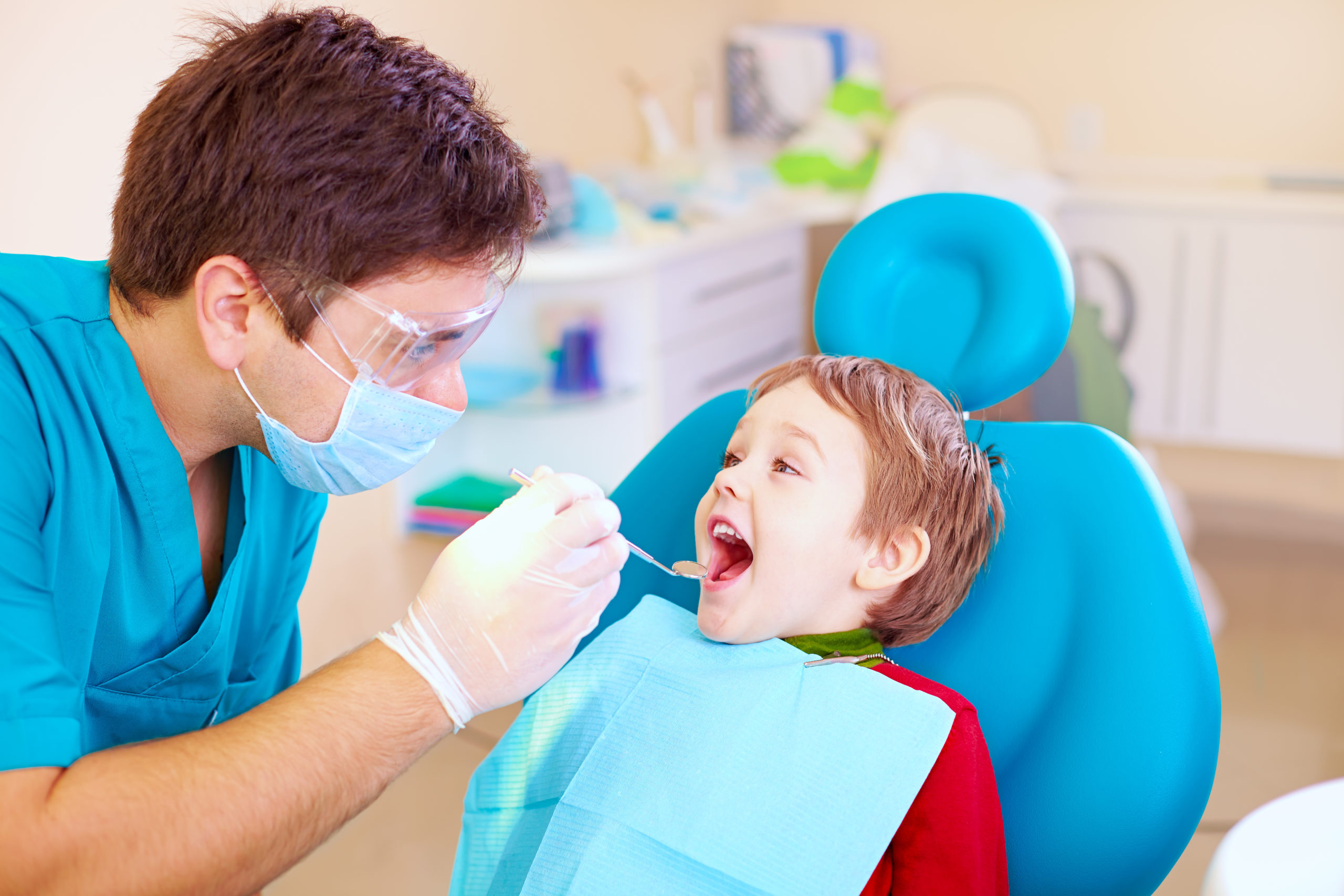 south calgary dentist giving a dental exam to a child